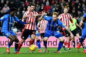 Sunderland forward Will Grigg is surrounded by Gillingham player on Tuesday night.