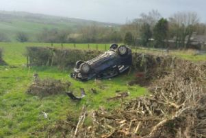 The driver escaped with minor injuries after losing control of the vehicle in Littlefell Lane, Lancaster this morning (March 13).