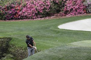 Ian Poulter chips close for a birdie from the bank of Rae's Creek at the 13th at Augusta National (Picture: David J Phillip/AP).
