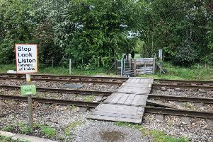 The 'dangerous' pedestrian rail crossing which will be replaced by a footbridge.
