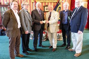 The cheque presentation by Preston Pals at the Lancashire Infantry Museum :(L to R): Simon Mather, Aidan Turner-Bishop, Andrew Mather (presenting cheque), John Downham (receiving cheque), Robin Utracik and Trevor Kirkham.'Photo by Roger Goodwin