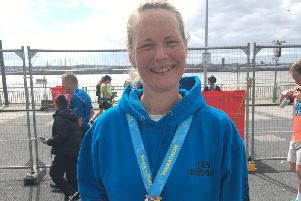 Smile of success after Jen completes her first marathon in aid of Sarcoma UK