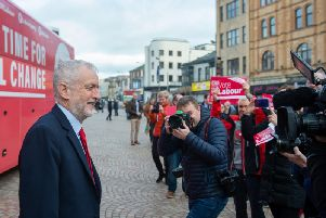 Labour Party leader Jeremy Corbyn poses in front of the battlebus in Blackpool during General Election campaigning on Tuesday November 12, 2019 (Picture: Joe Giddens/PA Wire)