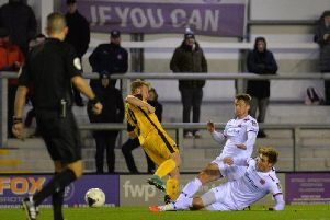 Neill Byrne and Dan Bradley in the thick of the action for Fylde against Sutton'Picture: STEVE MCLELLAN