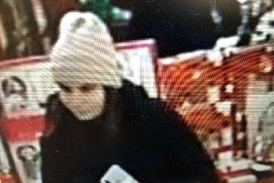 Police are appealing for information to identify the woman pictured to help with an investigation into a store theft.