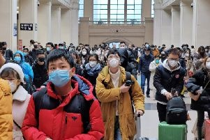 """People wear face masks as they wait at Hankou Railway Station on January 22, 2020 in Wuhan, China. A new infectious coronavirus known as """"2019-nCoV"""" was discovered in Wuhan last week. Health officials stepped up efforts to contain the spread of the pneumonia-like disease which medical experts confirmed can be passed from human to human. Cases have been reported in other countries including the United States,Thailand, Japan, Taiwan, and South Korea. It is reported that Wuhan will suspend all public transportation at 10 AM on January 23, 2020. (Photo by Getty Images)"""