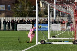 The ball flies past Dorking keeper Slav Huk for Nick Haughton's and Fylde's first goal  Picture: STEVE MCLELLAN