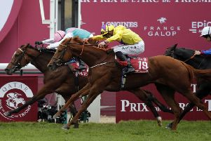 Enable, ridden by Frankie Dettori, just holds off fellow British filly Sea Of Class to win her second successive Qatar Ptix de l'Arc de Triomphe at Longchamp on Sunday.