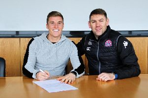 Manager Dave Challinor watches Dan Bradley sign for AFC Fylde Picture: AFC FYLDE