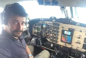 Joe Drury in the cockpit of one of the light aircrafts he has flown