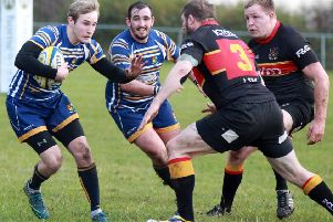 Action involving Dinnington, who crashed to a 36-0 defeat at Moortown.
