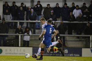 Danny Rowe scores the first of his two goals against Ramsbottom Picture: STEVE MCLELLAN