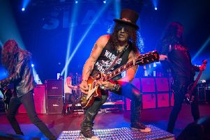 Slash still cuts an iconic figure