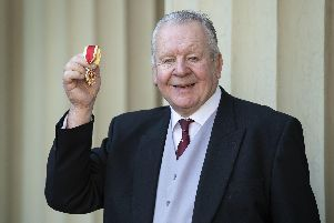 Bill Beaumont receiving his knighthood at Buckingham Palace