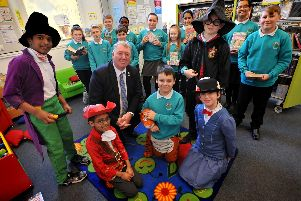 Coun John Kelly and students from Valley Road Academy launch a new reading challenge.