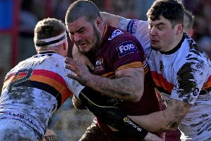James Brown attempts to find a way past Bradford defenders Ethan Ryan and Callum Bustin during last Sunday's Betfred Championship clash which saw Batley Bulldogs suffer a 16-6 defeat. Picture: Paul Butterfield