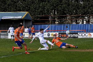 Jordan Tunnicliffe slides in to score what proved a consolation goal for Fylde Picture: STEVE MCLELLAN
