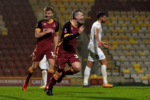 Top game: Paul Caddis celebrates scoring Bradford's third equaliser in the FA Cup replay against Peterbrough.