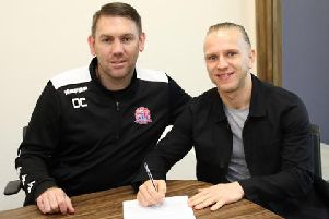 Manager Dave Challinor welcomes Matty Kosylo to Mill Farm.'Picture: AFC FYLDE