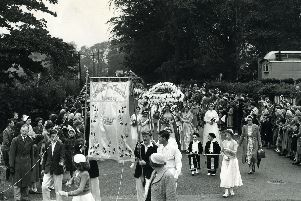 This photo from August 1956, shows the procession in Church Road. The leafy setting shows the village in all its summer glory, although those lining the streets look quite wrapped up for August! Maybe it was a chilly summer.