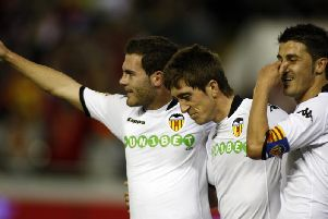 THE WAY WE WERE: Pablo Hernandez, centre, celebrates with Valencia team-mates Juan Mata and David Villa after Villa's goal in a La Liga clash against Real Zaragoza at Mestalla Stadium on November 8, 2009. PICTURE BY JOSE JORDAN/AFP/Getty Images.