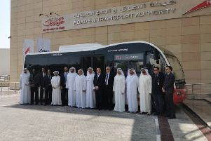 Representatives from Optare and Dubai's Road & Traffic Authority celebrate the launch of the RTA Solo. (S)