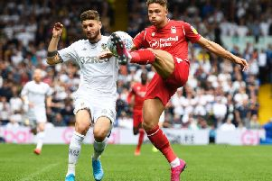 Forest's Matty Cash battles with Leeds United's Mateusz Klich.