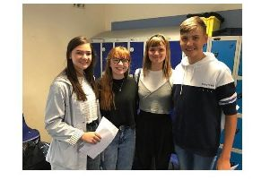 Students collect their results at Friesland School.