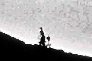 Is this the image of two ghostly figures on Stanage Edge?