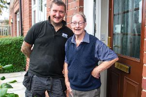 Lee Jackson (left) with pensioner Robert North (Photo: SWNS)