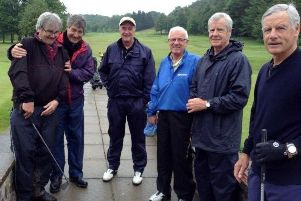 Mick Fenoughty (second from right) at Matlock Town's annual golf day in 2014 with brothers Tom (far right) and Nick (second from left).