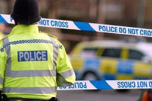 Police are investigating an incident after two cars caught fire near Dewsbury this morning.