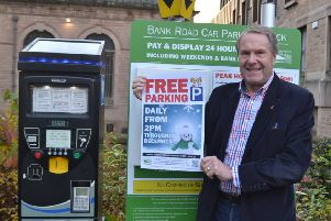 Council leader, Coun Garry Purdy, promoting the Christmas free parking initiative.