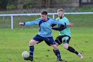 Mikey Thompson of Dewsbury Rangers challenges Kellingley's Jordan Hutchinson for possession last Saturday.