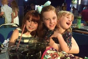 Lizzie's three daughters, Emilie, Scarlett and Izabelle. An online appeal has been set up to raise money for them and the whole fire-hit family.