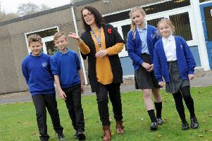 Head teacher, Fiona Cook and pupils, Luke, Dylan, Grace and Claribel, at Langley Mill Academy where new classrooms are going to be built for the increase of pupils now needing places.