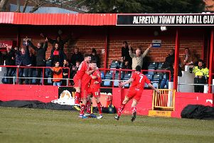 Alfreton's players and supporters celebrate Danny O'Brien's fabulous 50-yard strike to seal comeback win over leaders Chroley
