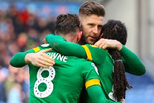 Paul Gallagher (centre) hugs Preston team-mates Alan Browne and Daniel Johnson