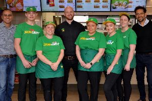 New Subway opened at Kirkby Precinct , the team are pictured with franchise owner Ama Mandeir and Subway business development agent Tesh Patel.