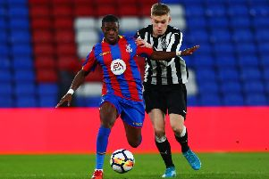 LONDON, ENGLAND - JANUARY 19:  Joseph Hungbo of Crystal Palace avoids a challenge from Matty Longstaff of Newcastle during the FA Youth Cup Fourth Round match between Crystal Palace and Newcastle United at Selhurst Park on January 19, 2018 in London, England.  (Photo by Jordan Mansfield/Getty Images)