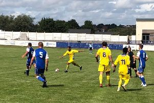Action from Matlock Town's 2-2 draw at Frickley.