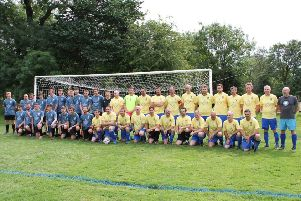 The two teams line up for the Darren Hibbert Community Cup match in Darley Dale.
