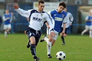 14 January 2012.....    Guiseley v Stalybridge Celtic, FA Trophy 3rd round'Lions Chris Senior outruns Celtics Jack Rea
