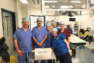 Consultant urologists Mr Iain Campbell and Mr Mohammad Masaarane with theatre practitioners Nicola Burnley (front), Clare Matthews and Tracy Gowerson following the first SpaceOAR operation