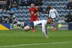Preston striker Louis Moult heads home against Wigan at Deepdale in August