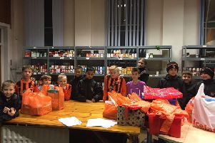 Howden Cough Under 10s players Rowan, Elliot, Oliver, Lucas W, Finlay, Abdullah, Dante, Lucas L, Jorja, Riley, Harry and Tommy at the food bank.