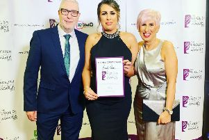 Beauty Queen's Kay Harding with her highly commended certificate at the English Hair and Beauty Awards.