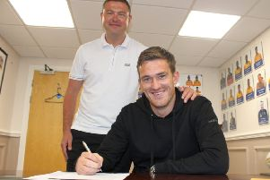 Andy Cook signs for John Dempster on Friday.