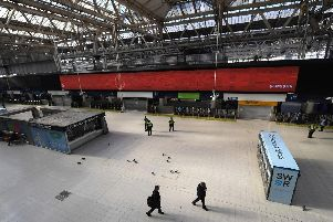 Police Office and National Rail Staff are seen at an empty Waterloo Station in London (Photo: Alex Davidson/Getty Images)