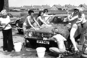Nurses holding a charity car wash in Lancashire in the summer of 1976